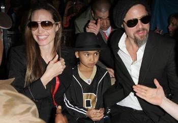Angelina Jolie, Maddox e Brad Pitt no SB44: adivinha para qual time torciam