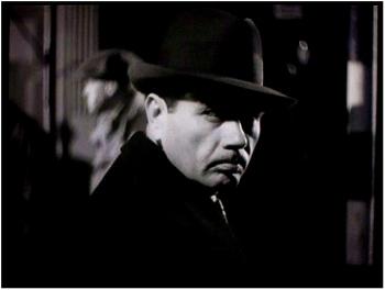 Mr. Verloc (Oskar Homolka)